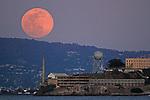Aprils Super full moon rising over Alcatraz Island.