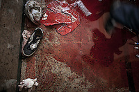 In this Wednesday, Aug. 14, 2013 photo, a puddle of blood is seen on the floor of a field hospital during clashes with security forces in streets around Al-Raba'a Alawya mosque in the Nasr district of Cairo. (Photo/Narciso Contreras).
