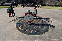 A child walks with an anti-abortion placard across the Ohio seal at a Pro-Life rally at the Statehouse in Columbus, Ohio, Monday, Nov. 23, 2006 on the 33rd anniversary of the Supreme Court Roe v. Wade decision.<br />