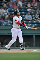 Second baseman Yoan Moncada (24) of the Greenville Drive bats in a game against the Greensboro Grasshoppers on Wednesday, August 26, 2015, at Fluor Field at the West End in Greenville, South Carolina. The Cuban-born 19-year-old Red Sox signee has been ranked the No. 1 international prospect in baseball by Baseball America. Greenville won, 7-0. (Tom Priddy/Four Seam Images)