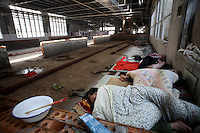 Workers sleep in the newly being constructed larger factory at Amity Printing Co in Nanjing, 03 Dec 2007,  which is a joint venture with the United Bible Society that produces millions of bibles annually.<br /><br />Photo by Qiali Shen/Sinopix