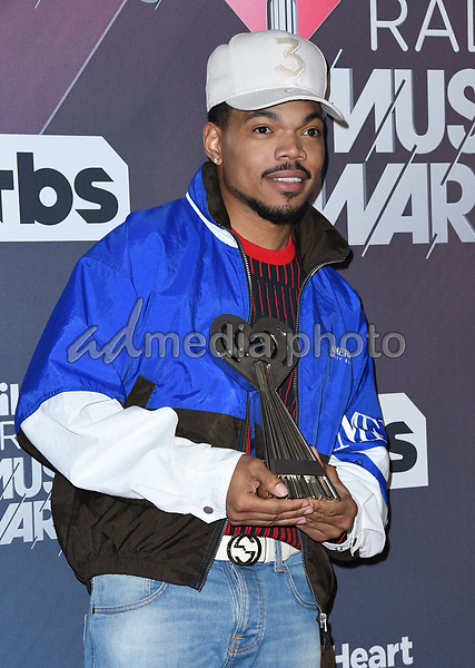 11 March 2018 - Inglewood, California - Chance the Rapper. 2018 iHeart Radio Awards - Press Room held at The Forum. Photo Credit: Birdie Thompson/AdMedia