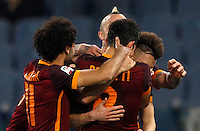 Calcio, Serie A: Roma vs Fiorentina. Roma, stadio Olimpico, 4 marzo 2016.<br /> Roma's Diego Perotti, back to camera, celebrates with teammates after scoring during the Italian Serie A football match between Roma and Fiorentina at Rome's Olympic stadium, 4 March 2016.<br /> UPDATE IMAGES PRESS/Riccardo De Luca