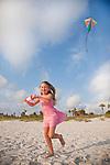 USA Florida, Girl (8-9) flying kite on St. Pete Beach