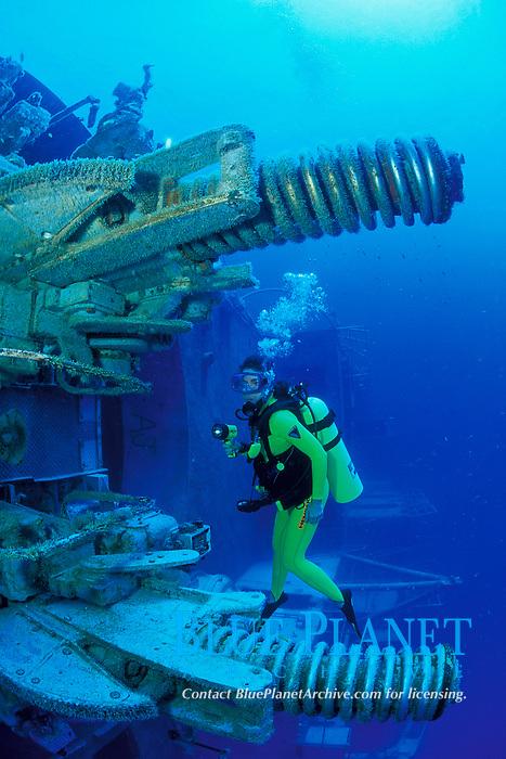 diver explores the port aft anti-aircraft guns of the Spiegel Grove a 510 foot U.S. Navy Landing Ship Dock (LSD), the largest artificial reef ever created, Key Largo, Florida, Atlantic Ocean
