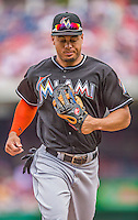 22 September 2013: Miami Marlins outfielder Giancarlo Stanton trots back to the dugout during a game against the Washington Nationals at Nationals Park in Washington, DC. The Marlins defeated the Nationals 4-2 in the first game of their day/night double-header. Mandatory Credit: Ed Wolfstein Photo *** RAW (NEF) Image File Available ***
