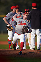 Illinois State Redbirds relief pitcher Jack Landwehr (18) warms up as head coach Bo Durkac (jacket) talks with the infield during a game against the Ohio State Buckeyes on March 5, 2016 at North Charlotte Regional Park in Port Charlotte, Florida.  Illinois State defeated Ohio State 5-4.  (Mike Janes/Four Seam Images)