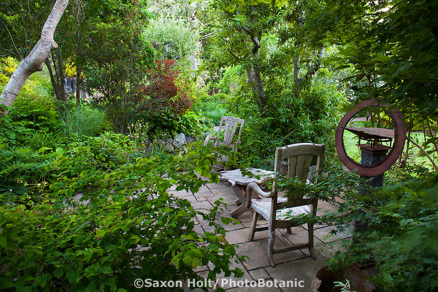 Secluded garden room small patio with rustic furniture Gary Ratway garden