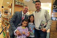 NO FEE PICTURES.15/10/11 Eason, Ireland's leading retailer of books, stationery, magazines and lots more, hosted a book signing by RTE presenter, Joe Duffy. Pictured at Eason,O'Connell Street, Dublin is Joe Duffy who signed copies of his new autobiography Just Joe..Follow Eason on Twitter @easons. Pictured with Joe Duffy are Ion Anghel, Romania who recieved an award from the Docklands for saving a man from the Liffey thanks to the Joe Duffy Show, and his daughters Emma, age 7 and Andrea, age 8. Pictures:Arthur Carron/Collins