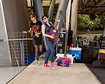 Raleigh, North Carolina- August 11, 2017<br /> <br /> (left to right) Mary Timony and Betsy Wright of Ex Hex hang out before the band took the stage. <br /> <br /> Ex Hex and Waxahatchee played an outdoor concert with MERGE Records label mates Superchunk at the North Carolina Museum of Art. (Photo by Jeremy M. Lange for The New York Times)