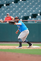 Akron RubberDucks first baseman Wilson Garcia (11) stretches for a throw during an Eastern League game against the Bowie Baysox on May 30, 2019 at Prince George's Stadium in Bowie, Maryland.  Akron defeated Bowie 9-5.  (Mike Janes/Four Seam Images)