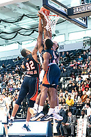WASHINGTON, DC - NOVEMBER 16: David Syfax Jr. #32 of Morgan State, Stanley Davis #0 of Morgan State and Troy Baxter #13 of Morgan State defend against Justin Williams #4 of George Washington during a game between Morgan State University and George Washington University at The Smith Center on November 16, 2019 in Washington, DC.