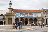 Cuba, Havana.  Plaza Vieja Fountain, Casa del Conde Jaruco behind.