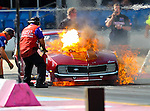 Pro Nitrous driver Robert Mathis (42) in his 1968 Camaro suffers a nitrous oxide explosion and fire during the ADRL World Final drag races which were held at the Texas Motorplex dragway in Ennis, Tx...