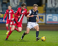 27th March 2021; Dens Park, Dundee, Scotland; Scottish Championship Football, Dundee FC versus Dunfermline; Max Anderson of Dundee shields the ball from Iain Wilson of Dunfermline Athletic