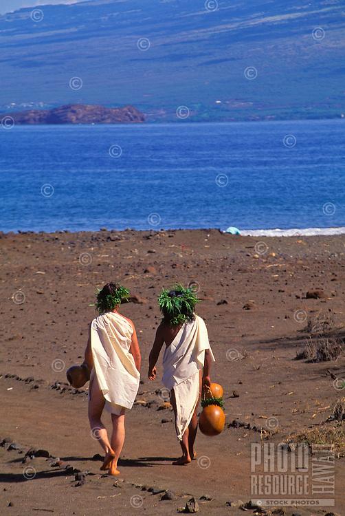 Hawaiian people in ancient dress near the water on the island of Kahoolawe