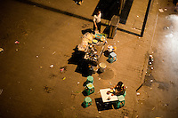 An overhead view of late night streetfood vendors near Ciqikou in the Shapingba district of Chongqing, China.
