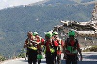 Personnel of the Alpine rescue service walk past a collapsed building in the village of Amatrice, central Italy, hit by a magnitude 6 earthquake at 3,36 am, 24 August 2016.<br /> Operatori del soccorso alpino camminano nei pressi di una casa distrutta dal terremoto che alle 3,36 del mattino ha colpito Amatrice, 24 agosto 2016.<br /> UPDATE IMAGES PRESS/Riccardo De Luca