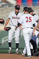 Kannapolis Intimidators starting pitcher Bernardo Flores (17) gets a visit on the mound from pitching coach Matt Zaleski (25) during the game against the Lakewood BlueClaws at Kannapolis Intimidators Stadium on April 9, 2017 in Kannapolis, North Carolina.  The BlueClaws defeated the Intimidators 7-1.  (Brian Westerholt/Four Seam Images)