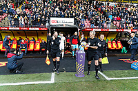 Referee Martin Atkinson grabs the ball as he leads the two teams to the pitch during the Premier League match between Watford and Swansea City at the Vicarage Road, Watford, England, UK. Saturday 30 December 2017