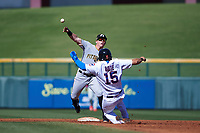 Glendale Desert Dogs second baseman Mitchell Tolman (12), of the Pittsburgh Pirates organization, attempts to turn a double play over David Bote (15) sliding in during an Arizona Fall League game against the Mesa Solar Sox on October 28, 2017 at Sloan Park in Mesa, Arizona. The Solar Sox defeated the Desert Dogs 9-6. (Zachary Lucy/Four Seam Images)