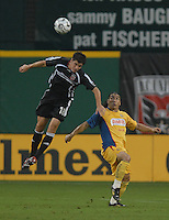 DC United defender Devon McTavish (18) goes up for a header while covered  by Club America forward Salvador Cabanas (9). DC United defeated Club America 1-0 to secure one of the two semifinal berths in SuperLiga group B, at RFK Stadium in Washington DC, Sunday July 29, 2007.