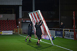 Fleetwood Town 5 Plymouth Argyle 1, 21/11/2020. Highbury Stadium, League One. The groundsmen dismantling the goals at the end of the game as Fleetwood Town take on Plymouth Argyle in a League One fixture at Highbury Stadium. Originally formed in 1908, the current Fleetwood Town were reformed in 1997, gained six promotions in 10 years and have been in League One since 2014, and have played at their current ground since 1939. The home team won this game 5-1, but due to COVID-19 restrictions, no spectators were allowed to attend the match. Photo by Colin McPherson.