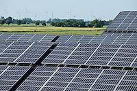 GERMANY Brokdorf, stable of farm with solar panel and wind turbines / DEUTSCHLAND Schleswig-Holstein, Brokdorf Stall mit Solarpanel und im Hintergrund Windkraftanlagen