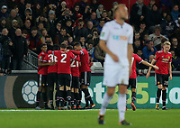Jesse Lingard of Manchester United is mobbed by team mates celebrating his second goal during the Carabao Cup Fourth Round match between Swansea City and Manchester United at The Liberty Stadium, Swansea, Wales, UK. Tuesday 24 October 2017