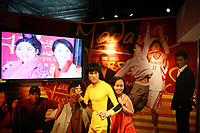 CHINA. Hong Kong. A tourist posing for a photograph with a waxwork of Bruce Lee, outside of Madame Tussaud's. Officially the Hong Kong Special Administrative Region, it is a territory located on China's south coast on the Pearl River Delta. It has a population of 6.9 million people, and is one of the most densely populated areas in the world. 2008