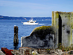 Abandoned pier in industial historic area of Tacoma, WA.  fronts yacht heading for Tacoma Yacht Club.  Waterfront of mixed recreational and industrial use.  Near superfund site.  Ruston Smelter, Aasarco.