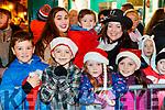Aodhagán O'Sullivan, Senan Prendergast, Grace O'Sullivan, Ciara Ní Shúilleabháin, Colm Óg O'Sullivan, Muireann O'Sullivan and Erin Prendergast, enjoying the Santa Parade in Killarney on Saturday evening last.