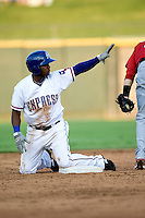 Round Rock Express third baseman Esteban German #6 calls time after stealing a base during a game against the Memphis Redbirds at the Dell Diamond on July 7, 2011in Round Rock, Texas.  Round Rock defeated Memphis 6-4.  (Andrew Woolley / Four Seam Images)