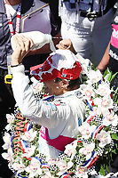30th May 2021, Indianapolis, Indiana, USA; NTT Indy Car Series driver Helio Castroneves pours milk over his head after winning the 105th running of the Indianapolis 500 on May 30, 2021 at the Indianapolis Motor Speedway in Indianapolis, Indiana.