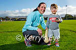 2 year old Arlo Barrett and his hurley with his mom Mary Barrett at Tralee Parnells juvenile training on Friday.