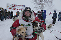 Second place finisher Ben Lyon poses with his lead dogs at the finish line of the Junior Iditarod on Willow Lake in Willow, Alaska.  Ben came in second just one minute behind first place winner Conway Seavey.