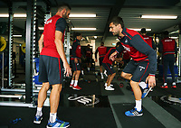 (L-R) Angel Rangel and Fernando Llorente exercise in the gym during the Swansea City Training at The Fairwood Training Ground, Swansea, Wales, UK. Wednesday 16 August 2017