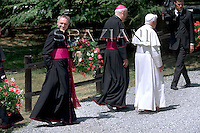 Pope Benedict XVI greets faithful as he arrives, in Introd, near Aosta, northern Italy, Monday, July 13, 2009. The pontiff will spend a period of rest in the Aosta Valley until July 29,