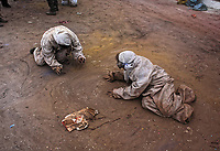 Pictured: Flour wars participants on the ground in Galaxidi, Greece. Monday 19 February 2018<br /> Re: Clean Monday (Monday of Lent) celebration of flour wars (Alevromoutzouroma) in the town of Galaxidi, which coincides with the beginning of the Greek Orthodox Lent in Greece. The origins of the custom are unclear, however it appears in its current form since the mid-19th century.<br /> Locals and visitors of all ages gather to collect large quantities of flour which they throw to each other. Various types of coloring is added for effect while people paint their faces with charcoal.