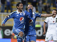 BOGOTÁ -COLOMBIA, 26-07-2014. Fabian Vargas (Izq) jugador de Millonarios celebra un gol en contra de La Equidad durante partido por la fecha 2 de la Liga Postobón II 2014 jugado en el estadio Metropolitano de Techo de la ciudad de Bogotá./ Millonarios player Fabian Vargas (L) celebrates a goal against La Equidad during match for the second date of the Postobon League II 2014 played at Metropolitano de Techo stadium in Bogotá city. Photo: VizzorImage/ Gabriel Aponte / Staff