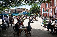 """BOGOTA - COLOMBIA, 05-09-2020: Primer día del piloto de apertura de restaurantes y cafés al aire libre, denominado """"Bogotá a Cielo Abierto"""", en el Chorro de Quevedo en el centro de Bogotá que ahora tiene sus calles pintadas con formas geométricas en pintura neón y cuenta con mesas, distribuidas estratégicamente para mantener el distanciamiento físico al finalizar la cuarentena total en el territorio colombiano causada por la pandemia  del Coronavirus, COVID-19. / First day of the pilot for the opening of restaurants and outdoor cafes, called """"Bogotá a Cielo Abierto"""", in Chorro de Quevedo in the center of Bogotá, which now has its streets painted with geometric shapes in neon paint and has tables, strategically distributed to maintain physical distancing at the end of the total quarantine in the Colombian territory caused by the Coronavirus pandemic, COVID-19. Photo: VizzorImage / Johan Rugeles / Cont"""