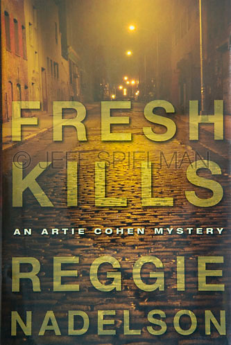 FRESH KILLS, by Reggie Nadelson<br /> <br /> Published by Walker and Company, New York<br /> 2007 Hardcover Edition<br /> Jacket Design by John Candell<br /> <br /> Photo available from Getty Images.  Please search for image # a0142-000080 on www.gettyimages.com.