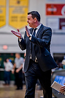 12 March 2019: Binghamton University Bearcat Head Coach Tommy Dempsey watches his team during the America East Semifinal Men's Basketball playoff game against the University of Vermont Catamounts at Patrick Gymnasium in Burlington, Vermont. The top-seeded Catamounts defeated the Bearcats 84-51, ending Binghamton's 2018-2019 season. Mandatory Credit: Ed Wolfstein Photo *** RAW (NEF) Image File Available ***