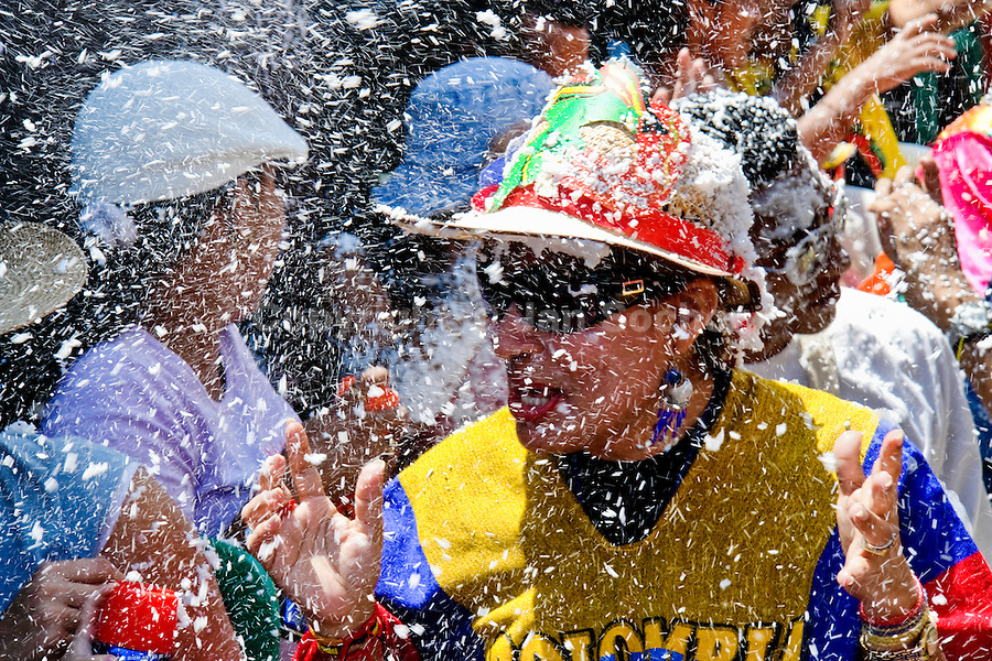 A Colombian man caught in the foam battle during the Carnival in Barranquilla, Colombia, 25 February 2006. The Carnival of Barranquilla is a unique festivity which takes place every year during February or March on the Caribbean coast of Colombia. A colourful mixture of the ancient African tribal dances and the Spanish music influence hit for five days nearly all central streets of Barranquilla. Those traditions kept for centuries by Black African slaves have had the great impact on Colombian culture and Colombian society. In November 2003 the Carnival of Barranquilla was proclaimed as the Masterpiece of the Oral and Intangible Heritage of Humanity by UNESCO.