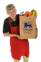 Photography sample: Retail employee portrait (actual employees used). Photo taken on seamless backdrop brought to store.