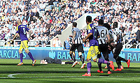 Pictured: Referee Chris Foy on the ground after getting knocked over by a deflection from a Jonjo Shelvey shot of Swansea. Saturday 19 April 2014<br /> Re: Barclay's Premier League, Newcastle United v Swansea City FC at St James Park, Newcastle, UK.