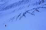 Solo alpinist finding his way between crevasses, Glacier de Tré-la-Tête, Mont-Blanc Massif, France, 2011.