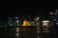 Mongolia, Ulaanbaatar. Sukhbaatar Square at night.