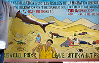 In a migrants' shelter in Gao, a mural depicts the dangers of travelling through the desert.