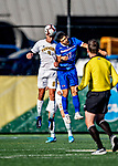 26 October 2019: University of Vermont Catamount Defender Arnar Steinn Hansson, a Senior from Garðabær, Iceland, goes up against University of Massachusetts Lowell River Hawk Forward Alejandro Osorio, a Senior from Hollywood, FL, in second half action at Virtue Field in Burlington, Vermont. The Catamounts rallied to defeat the River Hawks 2-1, propelling the Cats to the America East Division 1 conference playoffs. Mandatory Credit: Ed Wolfstein Photo *** RAW (NEF) Image File Available ***